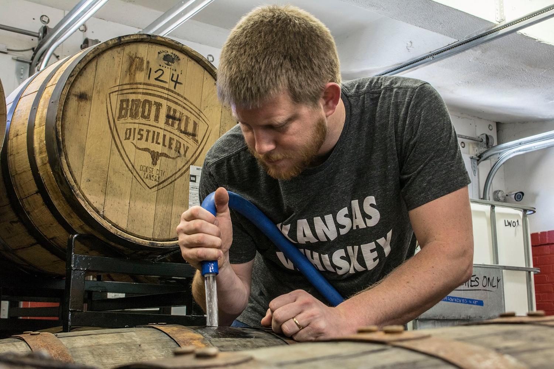 Hayes Kelman fills a bourbon barrell